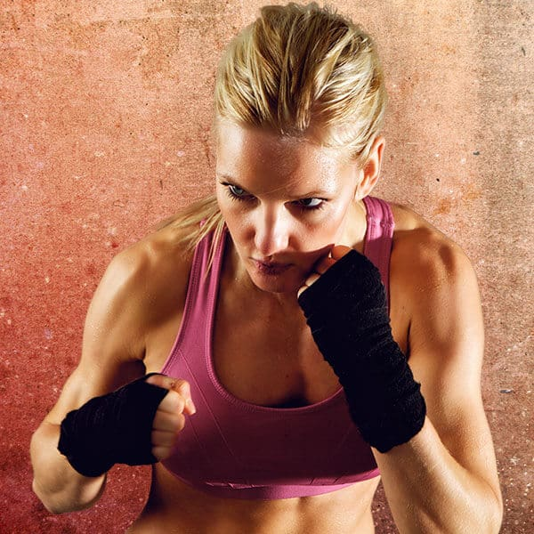 Mixed Martial Arts Lessons for Adults in Lake Jackson TX - Lady Kickboxing Focused Background