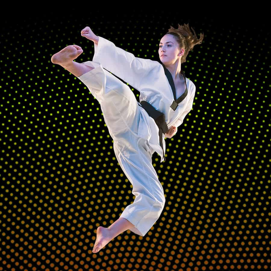 Martial Arts Lessons for Adults in Lake Jackson TX - Girl Black Belt Jumping High Kick