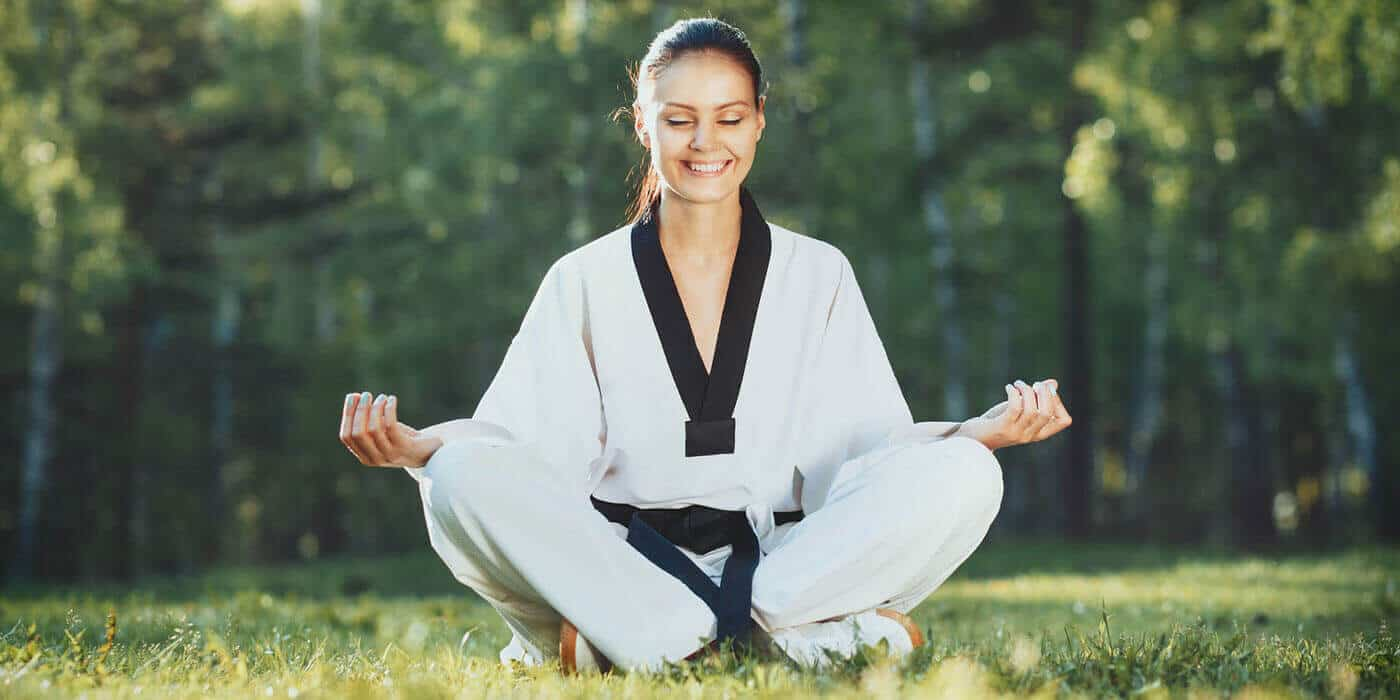 Martial Arts Lessons for Adults in Lake Jackson TX - Happy Woman Meditated Sitting Background